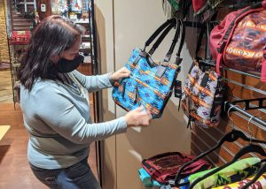 Woman shopping at the Akwesasne Mohawk Casino wearing a mask